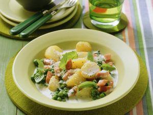 Erbsen-Kartoffeltopf mit Sahne und Schinkenwürfeln Rezept